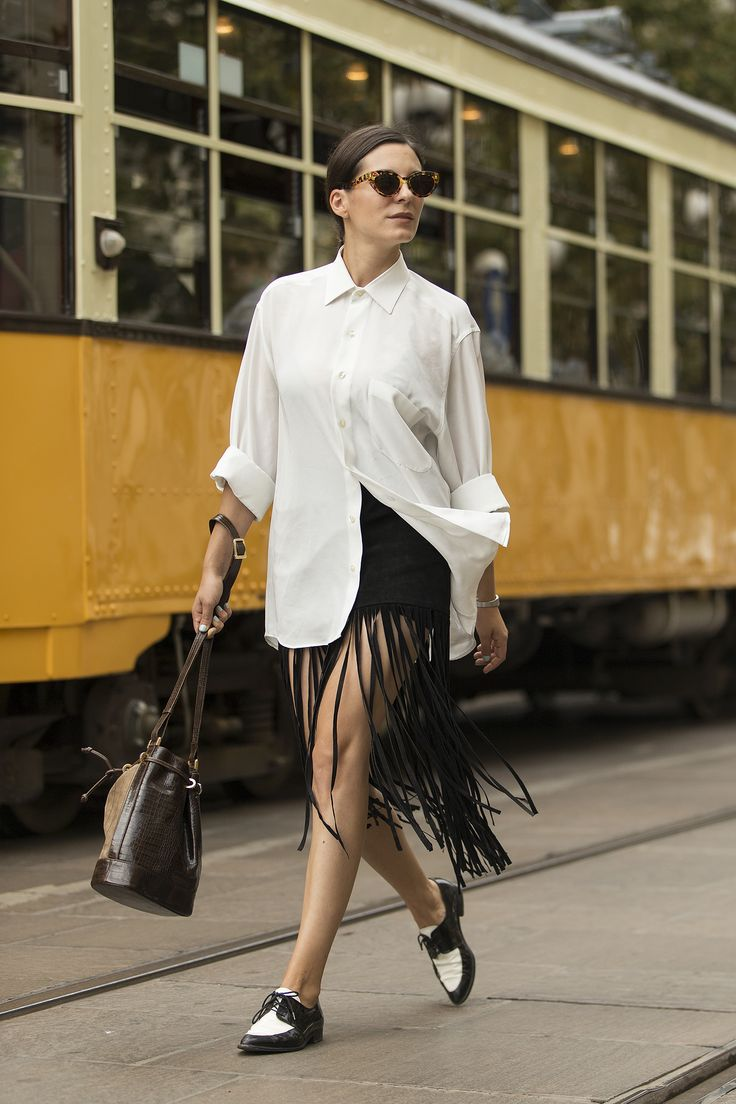 white shirt, leather fringing & brogues. #AndreeaBogdan in Milan.