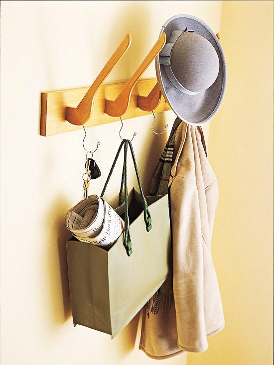 Get Creative with Unexpected Storage Solutions Unique Coat Rack Mounted hangers serve as a unique coat rack for easy entryway organization. Attach sawed-off wooden hangers to a board by screwing them in through the back. Add heavy-duty picture hangers to the back of the board for mounting on the wall. Throw hats on top and hang purses and coats on the hangers' hooks. Watch the Video