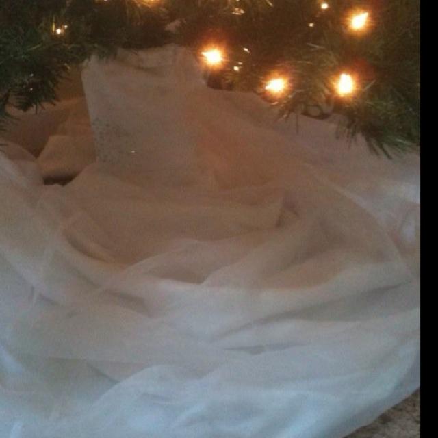 We use my wedding dress as the christmas tree skirt that way ever