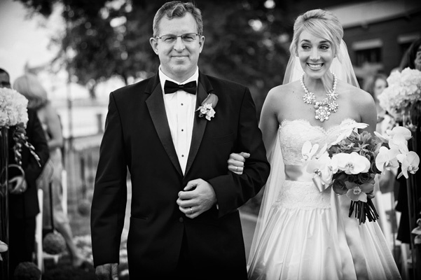 Ali and her dapper dad walking down the aisle.