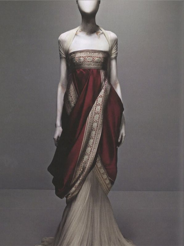 Alexander McQueen - The Girl Who Lived in the Tree autumn/winter 2008-9. Overdress of red silk woven with silver jacquard borders; underdress of ivory silk tulle. exhibited at Savage Beauty at the Met Museum 2011 http://blog.metmuseum.org/alexandermcqueen/objects/ #dress #fashion