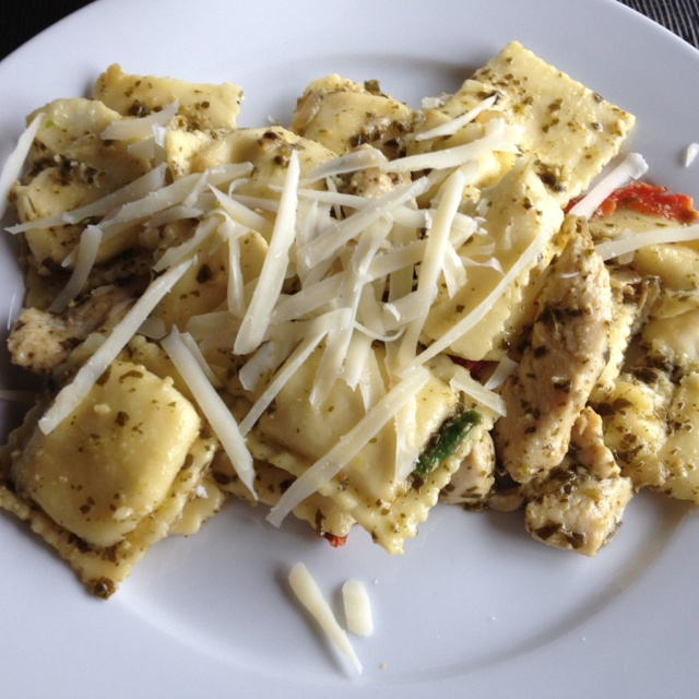 Cheese ravioli with pesto, red peppers and grilled chicken.