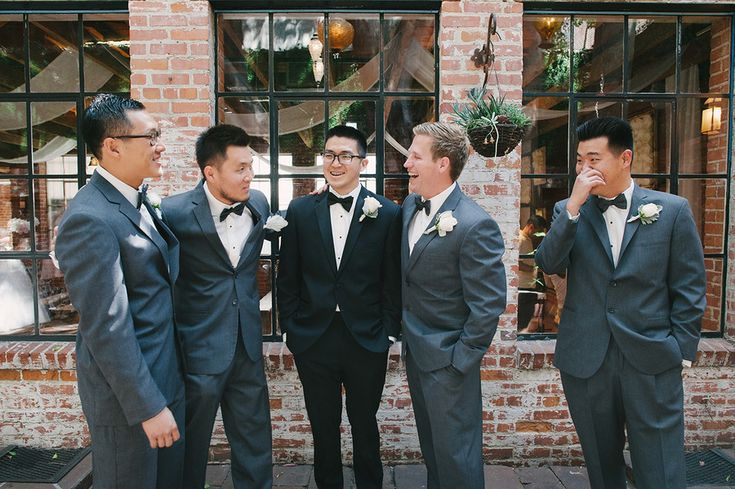 Try dressing the groomsmen in a different colored suit than the groom. The grey and black look great together!  DIY Los Angeles Wedding from Perpixel Photography