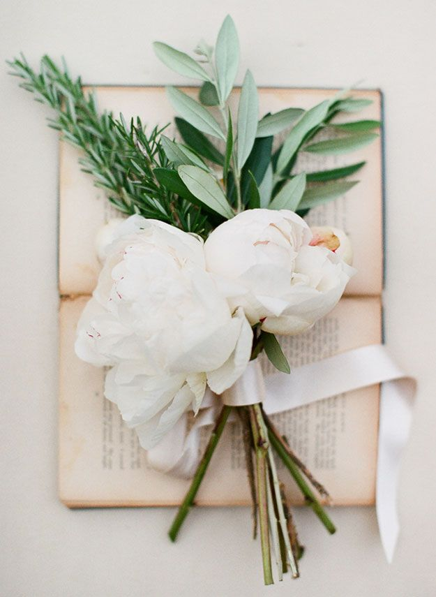 A bouquet of rosemary, olive leaf and cream peonies photographed by Jemma Keech