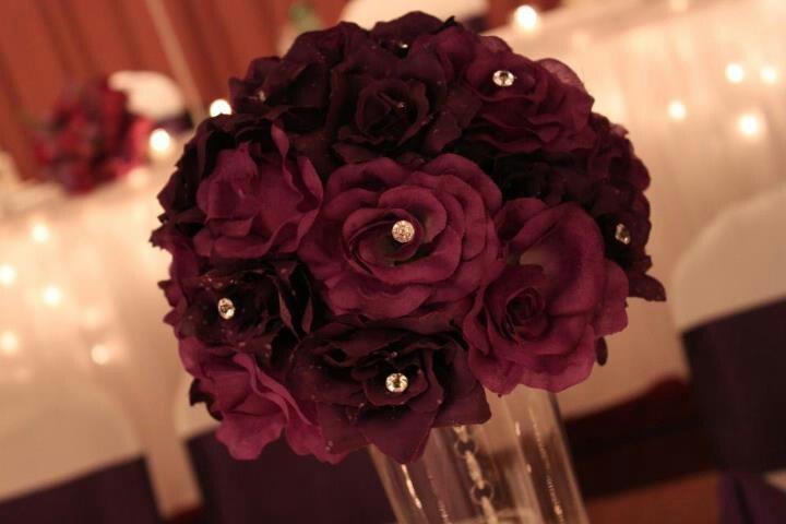 DIY purple centerpiece. Silk flowers. Trim stems and insert into ...
