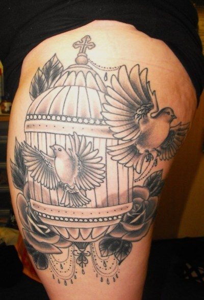 Bird Flying Out of Cage Tattoo