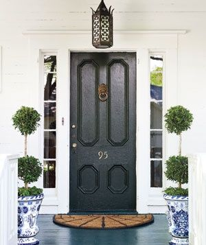 blue and white planers, black door and filigree lantern