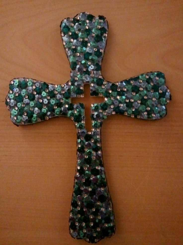 Home made cross. Started out with a simple wooden cross from Michael's. I then bought shiny confetti and glued them on with a glue gun. Filled the rest of the spaces with rhinestone stickers I had purchased awhile back for my nails. This project takes patience but its affordable everything was less then $10.
