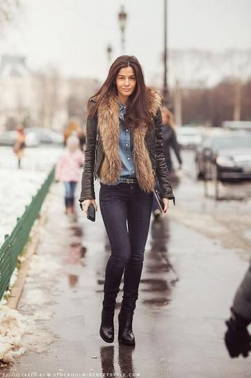 25 ways to wear a faux fur vest - under a leather coat with chambray shirt and skinny jeans