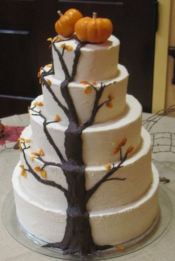 fall themed wedding cake with a tree and pumpkins