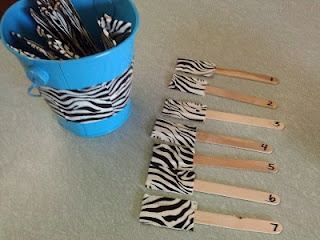 duck tape one end of popsicle sticks, flip over after you called on student (instead of painting the ends)