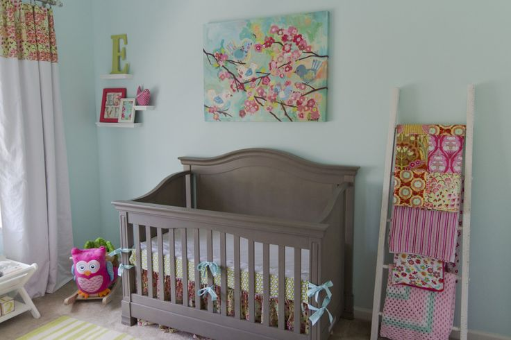 Cheerful Aqua, Pink and Green Nursery - we love the ladder to display/store baby blankets!