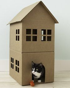 A DIY cardboard cat playhouse. So cute! If you have kids, let them decorate it.