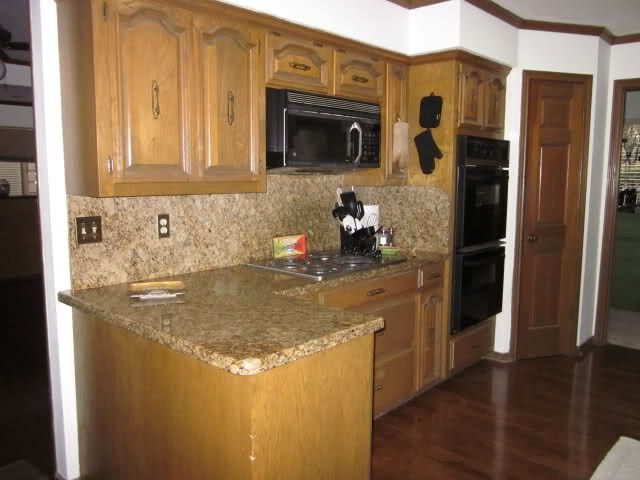 kitchens with light wood cabinets and dark wood floors  Need granite