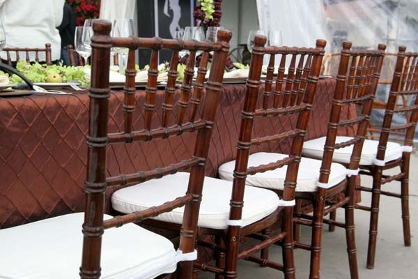 Allie s party rental fruitwood chiavari chairs with ivory pads