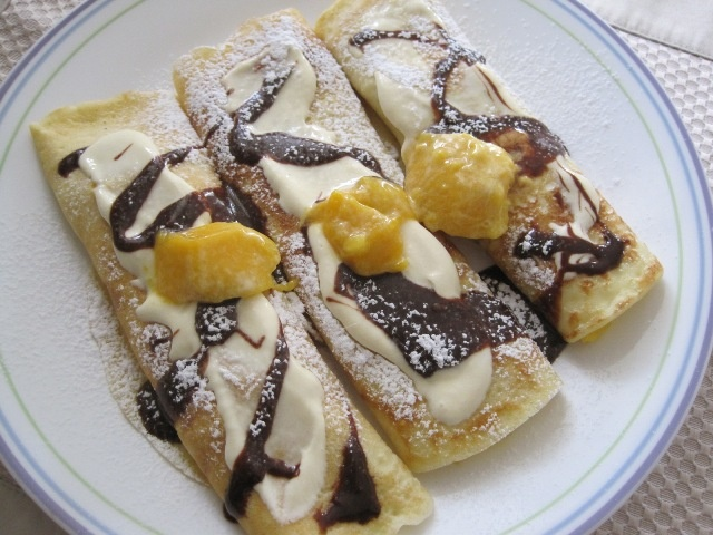 Mango Crepes with cream and Nutella syrup. :)