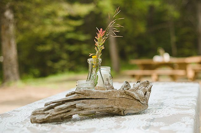 Rocky mountains campground wedding leah mackenzie for Driftwood table centerpieces