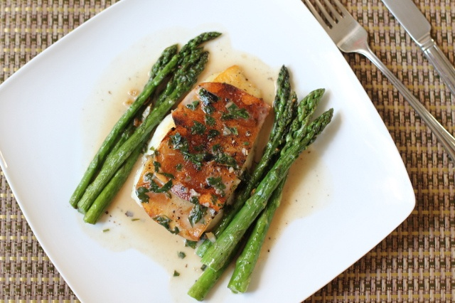 Potato crusted halibut with white wine sauce and asparagus