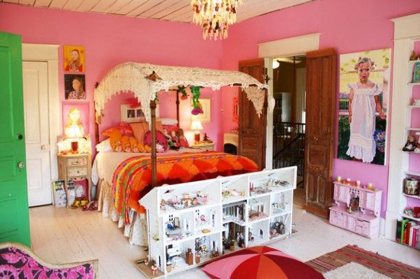 This Pink Bedroom With The Canopy Bed And The Big Doll House In