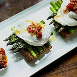 Poached egg on toast with a warm bacon vinaigrette and roasted