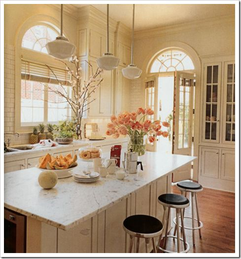 White kitchen with peach tulips, arched dormer windows, streamlined