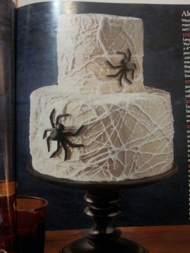 Halloween cake with stringed marshmallows.... Microwave mm til gooey 30 sec stir then pinch off pieces and string over cake