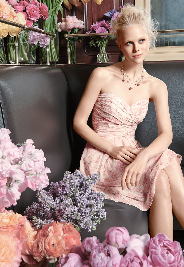 Spring's in bloom (literally) with this pretty pink print! Your bridesmaids will look sweet & chic in feminine chiffon #bridesmaiddress Style F15667, only at David's Bridal.