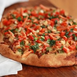 Thai Chicken Pizza with spicy peanut sauce and lots of veggies.