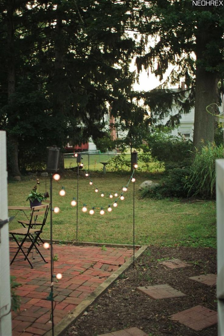 Backyard Bargain Tiki Torches : Tiki torches and solar lights border patio area Simple and cheap!