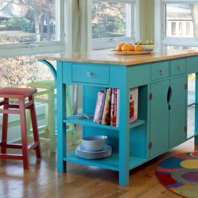 Love this turquoise kitchen island! Great accent piece