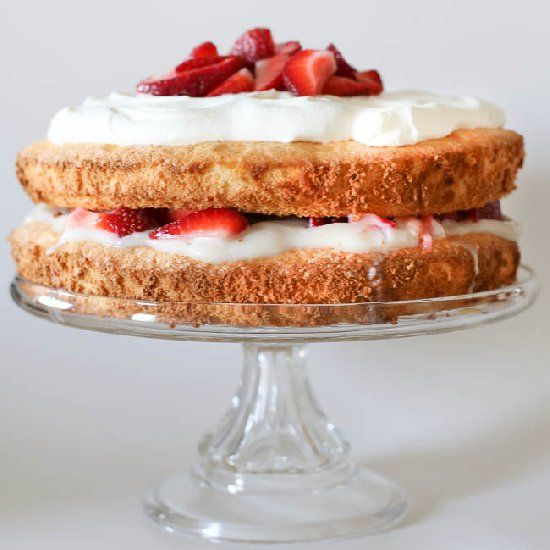Lemon soaked sponge cake layered with strawberries and pudding and ...