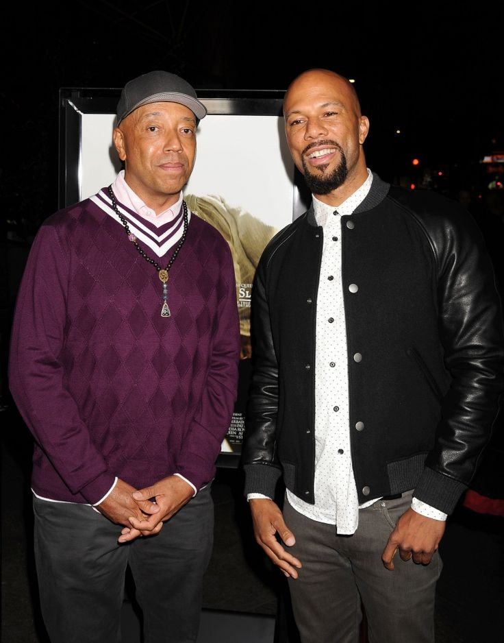 "Producer Russell Simmons and Common play a game of ""who's ready for the photo"" as they attend the Los  Angeles premiere of 12 Years A Slave on Oct. 14"