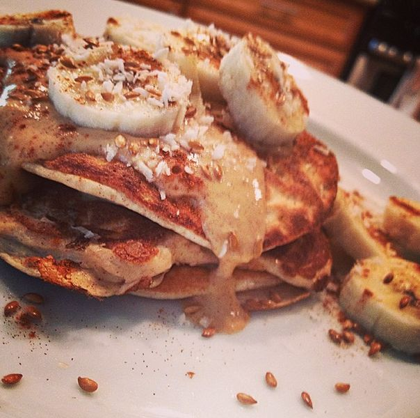 Pancakes topped with bananas, flaxseed, peanut butter, cinnamon ...