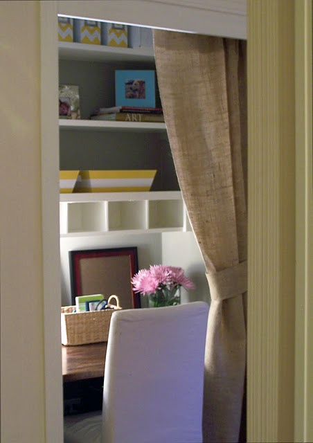 Office in a Closet - love the cubbies and burlap curtain