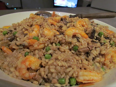 Paprika-laced shrimp risotto with wild mushrooms and peas