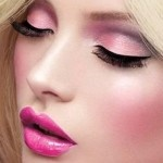 rosey colored blush, with fake, dramatic eyelashes. The eye shadow has many different shades of pink, coral and purples.