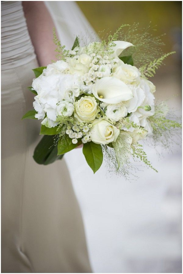 A BEAUTIFUL blend of white, cream and green flowers, fillers and greens. The varying shades of white and cream only add to the beauty of the bouquet.