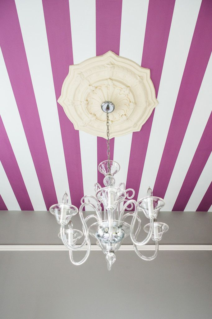 We love an element of surprise in a child's room! This purple and white striped ceiling provides just that.  #BRITAXStyle