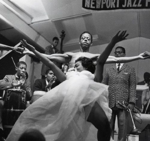 Eartha Kitt dances during Dizzy Gillespie's set at the Newport Jazz Festival, 1954.