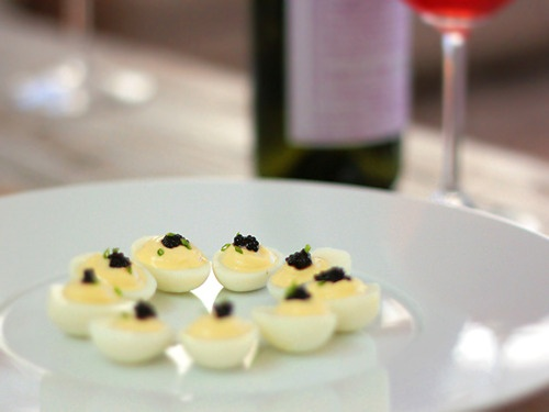 deviled quail eggs with caviar. hello, deliciousness!