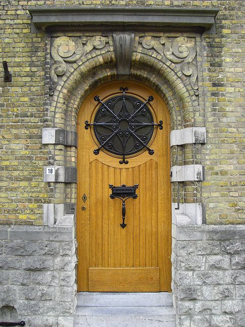 Wooden Door Made of Oak and Carved Stone Frame