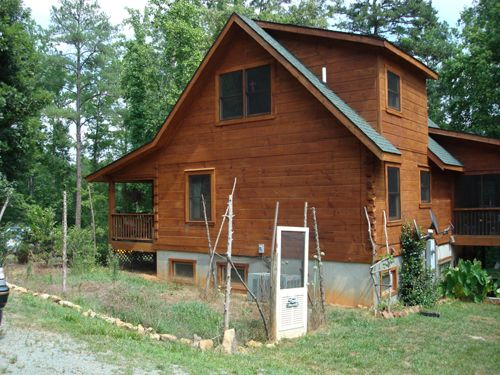 Log and timber frame home additions screened porch for Log cabin additions ideas