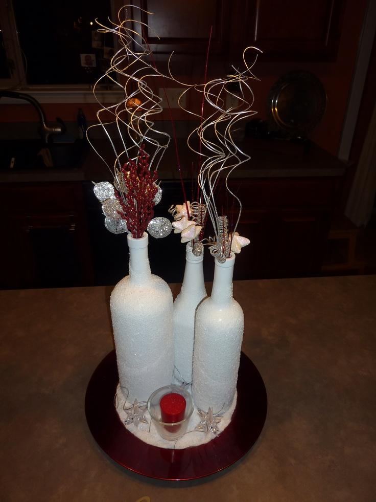 Wine bottle centerpiece future wedding pinterest for Wine bottle wedding centerpieces