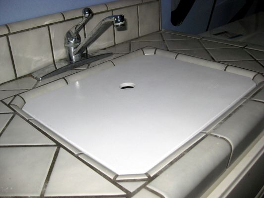 Sink cover for laundry room creates more counter space, while keeping ...