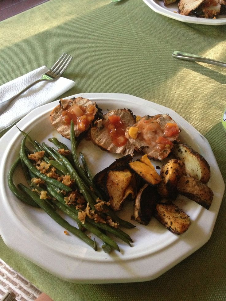 Roasted pork with mango salsa, asparagus, and roasted sweet potatoes