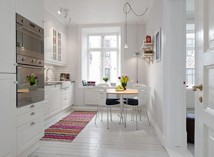 clean and simple kitchen. white painted hardwood floors.  Kök | Alvhem Mäkleri