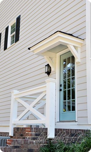 Small roof awning over outside door decor i 39 ll never for Side doors for houses