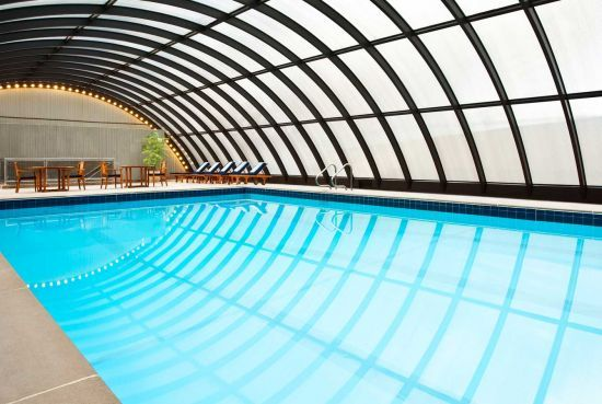 Pin by beverly hart on arches in architecture pinterest for Indoor pool with retractable roof