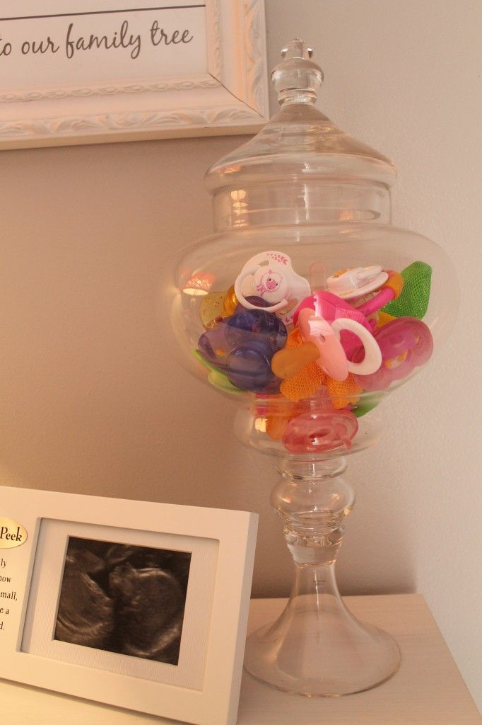 Use an apothecary jar to store pacifiers! Cute and functional. #nurserystorage