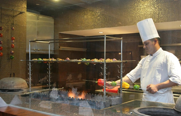"""Experience culinary perfection at the """"Kabab Hut """" and elegantly decked Indian Specialty restaurant, serving the extraordinary flavours of authentic Awadhi fare."""